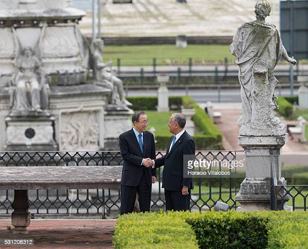 The Secretary General of the United Nations, Ban Ki Moon, and Portuguese President Marcelo Rebelo de Sousa shake hands during their walk through the...