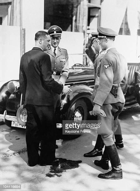 The Secretary General of the Vichy police Rene BOUSQUET speaking with the head of the SS and of the German police in occupied France General Karl...