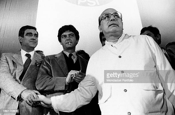 The secretary of Italian Socialist Party Bettino Craxi shaking hands with Italian union officer Agostino Marianetti during an electoral meeting The...