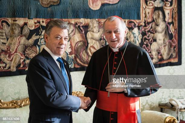 The Secretary of State of the Holy See Pietro Parolin shaking hands with Colombian president Juan Manuel Santos Vatican City 16th December 2016