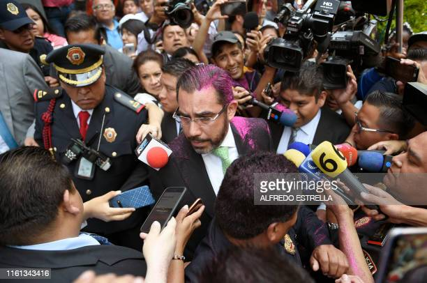 TOPSHOT The Secretary of the Public Security of Mexico City Jesus Orta Martinez with his hair sprayed by a demonstrator is hounded by the press...