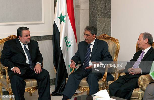 The secretarygeneral of the Arab League Amr Moussa meets with to the Speaker of Iraq's Transitional National Assembly Hajim alHassani and Ahmed bin...