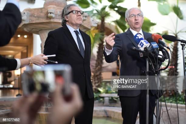 The SecretaryGeneral of the Organization of American States Luis Almagro listens to Venezuelan opposition leader and former Caracas Mayor Antonio...