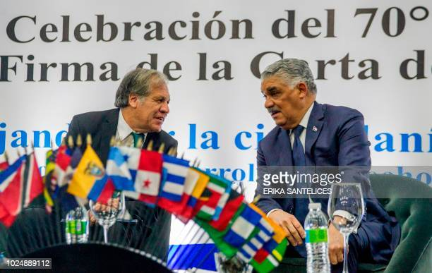 The SecretaryGeneral of the Organization of American States Uruguayan Luis Almagro speaks with Dominican Foreign Minister Miguel Vargas Maldonado...