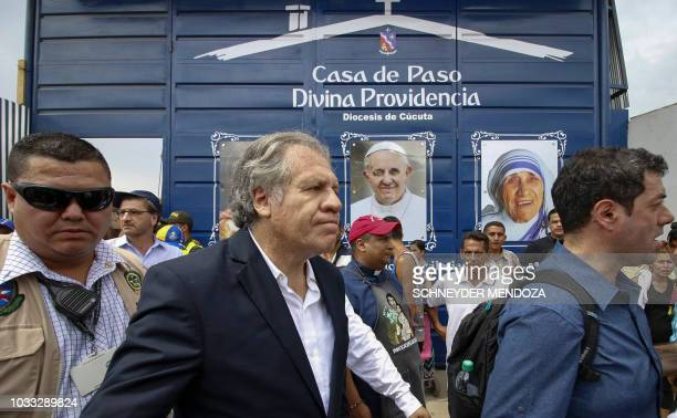 The SecretaryGeneral of the Organization of American States Uruguayan Luis Almagro greets Venezuelans during his visit to the Divina Providencia...