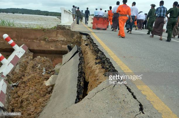 The section of a bridge near capital Naypyidaw along Yangon to Mandalay highway is damaged by rampaging flood waters from Swar Chaung dam on August...