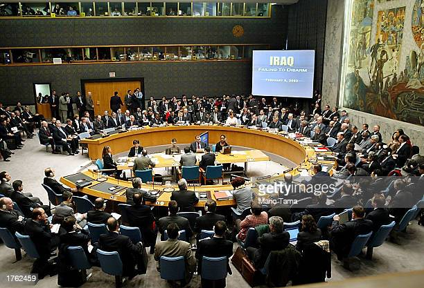The Security Council looks at a video screen during US Secretary of State Colin Powell's address to the UN Security Council February 5 2003 in New...