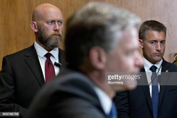 The security detail for Christopher Wray director of the Federal Bureau of Investigation center stand during a Senate Appropriations Subcommittee...