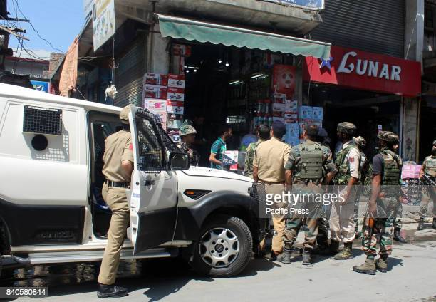 The security forces reviews the situation after unidentified gunman shot and critically injured a policeman Assistant SubInspector in south Kashmir's...