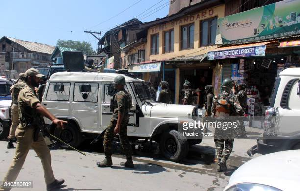 The security forces walking on spot after unidentified gunman shot and critically injured a policeman Assistant SubInspector in south Kashmir's...
