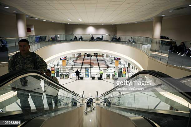 The security lines remain empty as delayed passengers find places to sit around Atlanta HartsfieldJackson International Airport after a snow storm on...