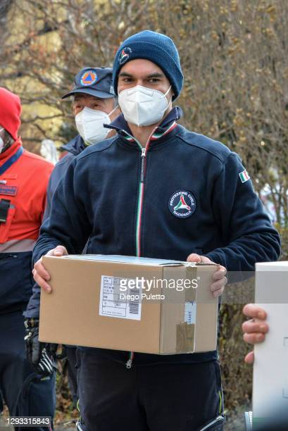 The security officer takes the first doses of the Pfizer-BioNTech COVID-19 vaccine outside the Amedeo di Savoia department of Turin on December 27,...