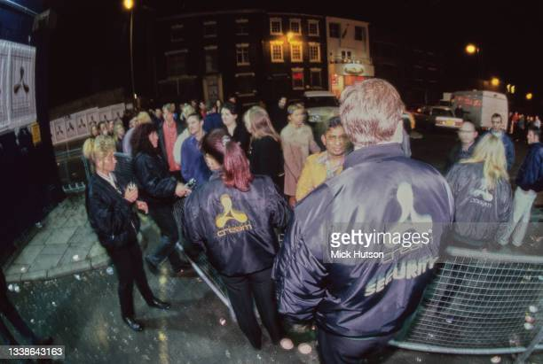 The security team of Cream nightclub checking clubbers upon entry, Liverpool, UK, circa 1995.