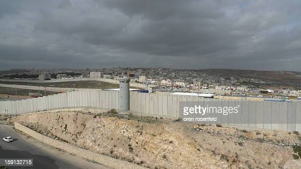 The security wall that separates Israel and Palestine seen here is Ramallah in the distance behind the wall, built by former Israeli Pm Ariel Sharon...