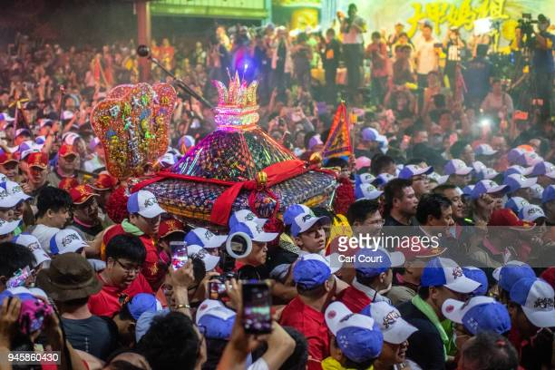 The sedan chair carrying a statue of the goddess Mazu is carried out of Jenn Lann Temple at the beginning of the nine day Mazu pilgrimage on April 13...