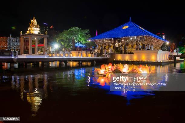 the seema malakaya buddhist temple is illuminatedat the night - buddha's birthday stock pictures, royalty-free photos & images