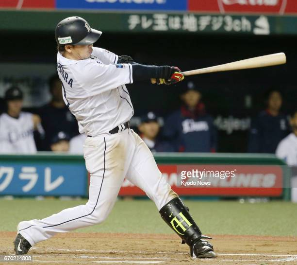 The Seibu Lions' Hideto Asamura hits a gamewinning sayonara double lifting his team to a 54 win over the Rakuten Eagles in 12 innings on April 19 in...