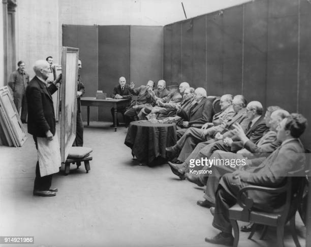 The selection committee judges artworks at the Royal Academy in London 31st March 1943 Amongst them is English architect Sir Edwin Lutyens