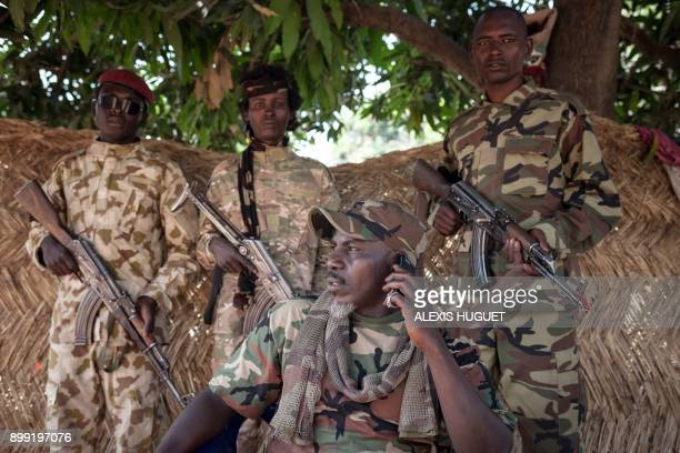 The selfproclaimed General Ahamat Bahar exSeleka exFPRC exMPC cofounder and now leader of the armed group MNLC poses for photographs in front of his...