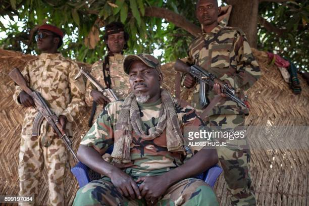 TOPSHOT The selfproclaimed General Ahamat Bahar exSeleka exFPRC exMPC cofounder and now leader of the armed group MNLC poses for photographs in front...