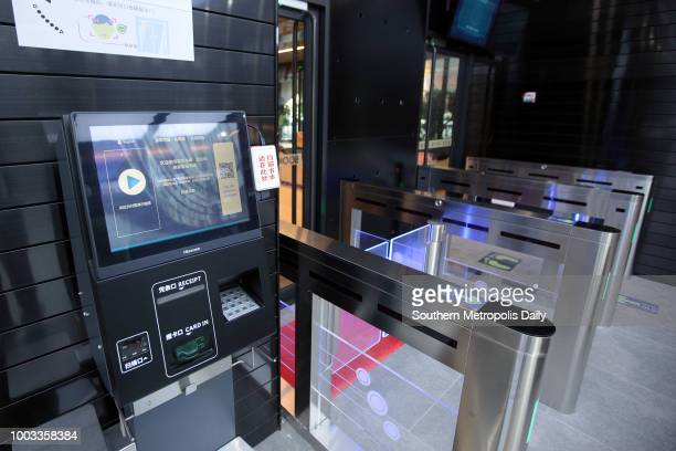 The selfservice payment machine is seen at an unmanned bookstore on July 17 2018 in Shenzhen Guangdong Province of China Customers can enter the...