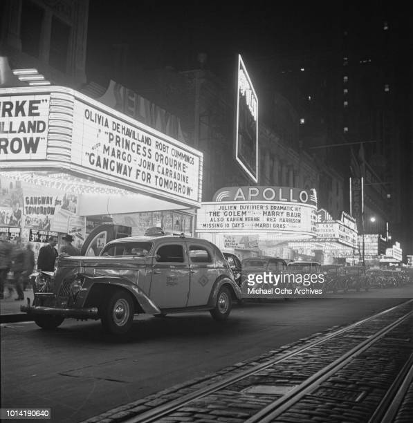 The Selwyn Theatre and Apollo Theatre on West 42nd Street, New York City, circa 1943. They are showing the films 'Princess O'Rourke', 'Gangway for...