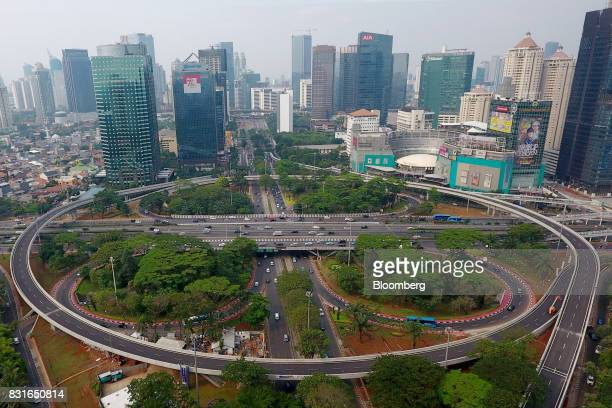 The Semanggi Interchange stands in front of buildings in the business district in this aerial photograph taken in Jakarta Indonesia on Sunday Aug 13...
