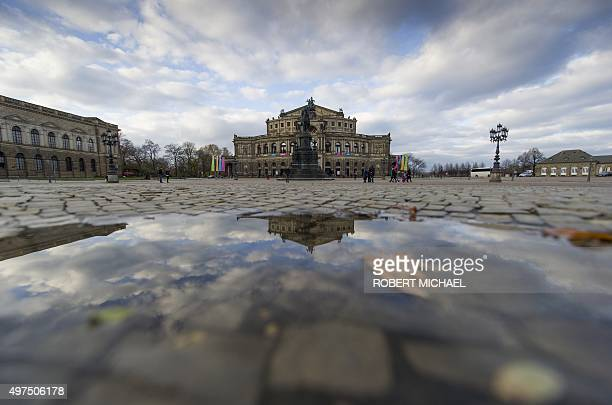 The Semperoper opera house in Dresden eastern Germany is reflected in a puddle on November 16 2015 MICHAEL