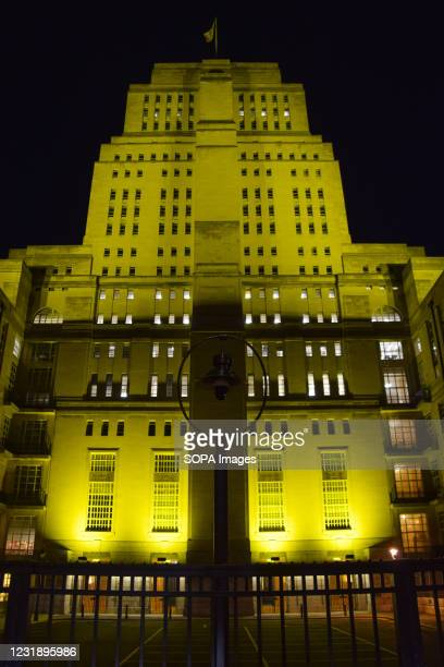 The Senate House, University of London, illuminated in yellow to mark the National Day Of Reflection. Many landmarks in the UK have been illuminated...