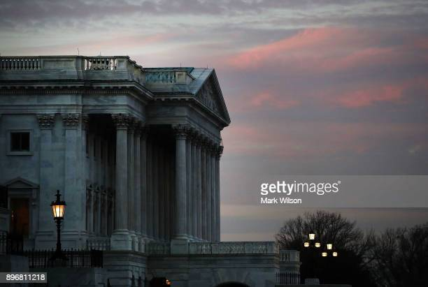 The Senate side of the US Capitol is shown as Congress votes on a stopgap measure that will avoid a government shutdown one day before the deadline...
