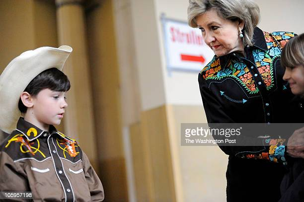 The Senator talks to her children Houston and Bailey at the Fort Worth Stock Show Rodeo Senior Senator and candidate for Texas governor Kay Bailey...