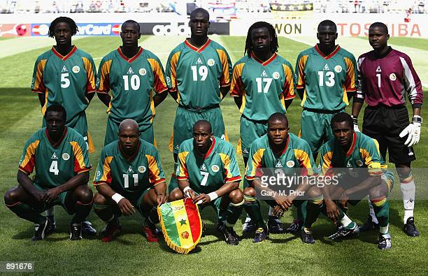The Senegal team pose for a team group before the first half of the Uruguay v Senegal Group A World Cup Group Stage match played at the Suwon World...