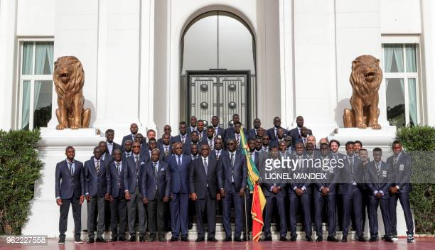 The Senegalese National Football poses for a photo with President Macky Sall at the Palace of the Republic during a ceremony in Dakar on May 23 ahead...