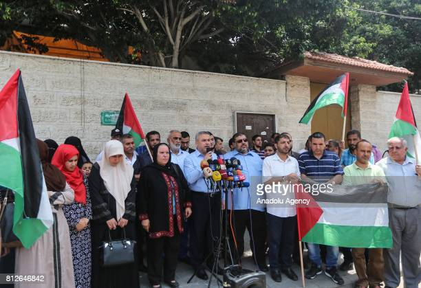The senior Hamas leader Ismail Radwan speaks to media in begalh of The Palestinian Prisoners Society during a demonstration demanding release of...