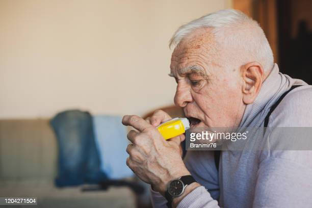 the senior man take daily dose of anti allergies medicine - asthma stock pictures, royalty-free photos & images
