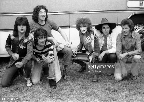 The Sensational Alex Harvey Band, group portrait, backstage at Reading, Festival, Reading, United Kingdom, 25 August 1973. L-R Chris Glen, Alex...