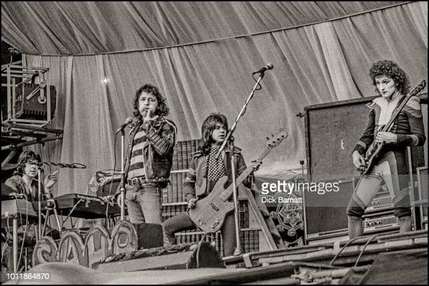 The Sensational Alex Harvey Band perform on stage at Stoke City Football Club, United Kingdom, 17th May 1975. L-R Hugh McKenna, Alex Harvey, Chris...