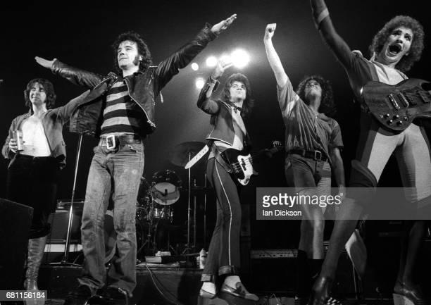 The Sensational Alex Harvey band performing on stage at New Victoria Theatre, London, 23 December 1975. L-R Hugh McKenna, Alex Harvey, Zal Cleminson,...