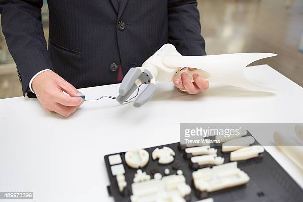The sensor which attaches to the users arm and controls this 3D printed prosthetic arm is demonstrated on September 21 2015 in Okayama Japan The...