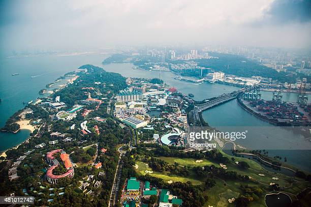 The Sentosa Gateway road center right leads to the Resorts World Sentosa integrated resort and casino complex operated by Genting Singapore Plc on...