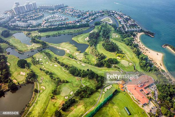 The Sentosa Golf Club stands next to the luxury property developments of Sentosa Cove on Sentosa Island in this aerial photograph taken above...