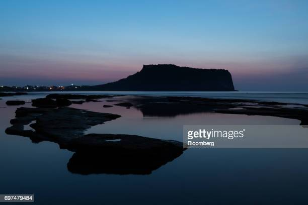 The Seongsan Ilchulbong peak a UNESCO World Heritage Site stands at dawn in Seogwipo Jeju South Korea on Wednesday June 14 2017 The election ofMoon...