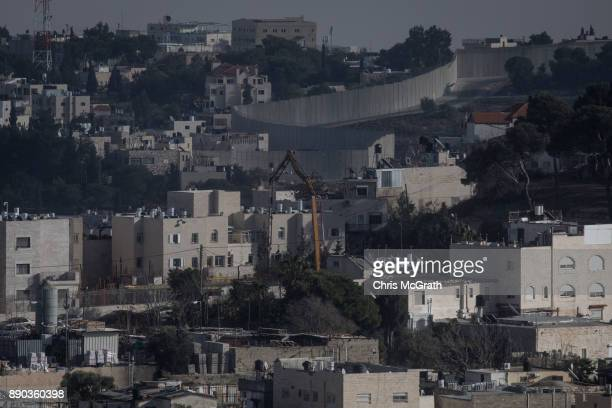The separation wall is seen in East Jerusalem on December 11 2017 in Jerusalem Israel In an already divided city US President Donald Trump pushed...