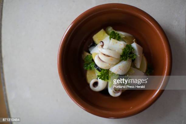 The sepia salad at Chaval made with cuttlefish celery pimenton potatoes lemon and police oil and squid ink aioli