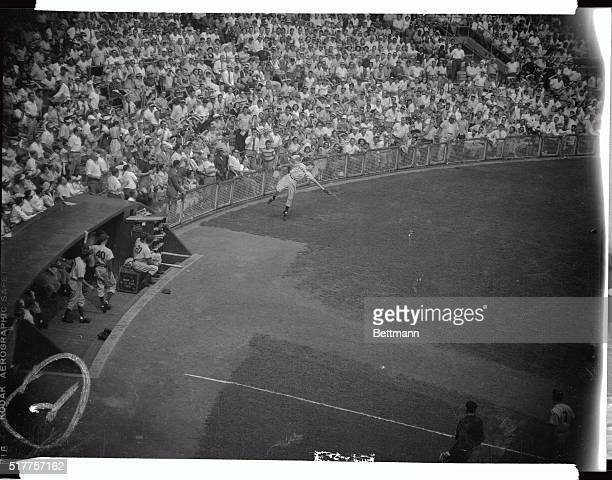 The sequence camera caught Giants third baseman Bobby Thomson snaring Dodgers first baseman, Gid Hodges foul fly along the 3rd base box seats in the...