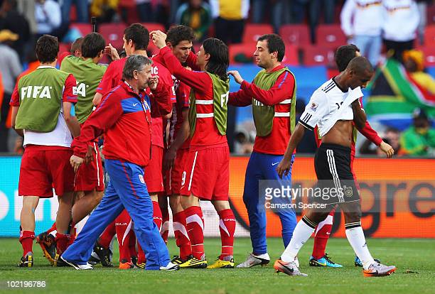 The Serbia team celebrate victory in the 2010 FIFA World Cup South Africa Group D match between Germany and Serbia at Nelson Mandela Bay Stadium on...