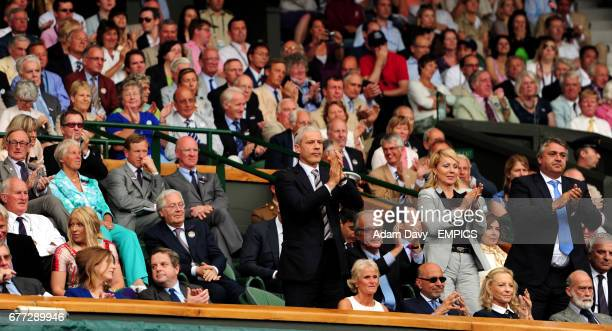 The Serbian President Boris Tadic stands to celebrate in the royal box after Serbia's Novak Djokovic defeated Spain's Rafael Nadal in the men's...