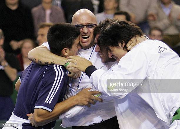 The Serbian team celebrate victory over Great Britain after Greg Rusedski of Great Britain lost to Novak Djokovic of Serbia Montenegro during day...