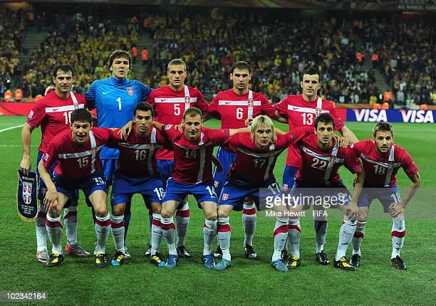 The Serbian team pose before the 2010 FIFA World Cup South Africa Group D  match between e24d5188b3da0
