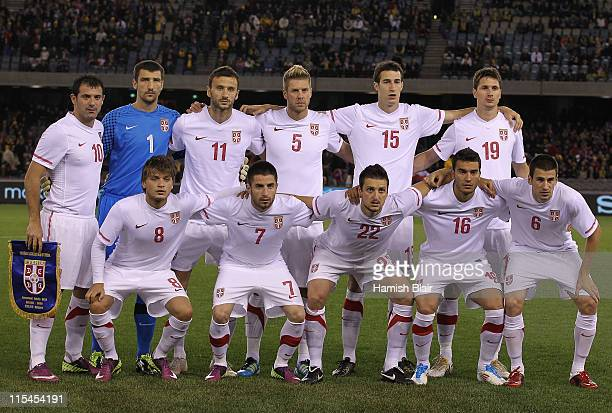The Serbian team pose for a team phot during the international friendly match between the Australian Socceroos and Serbia at Etihad Stadium on June...